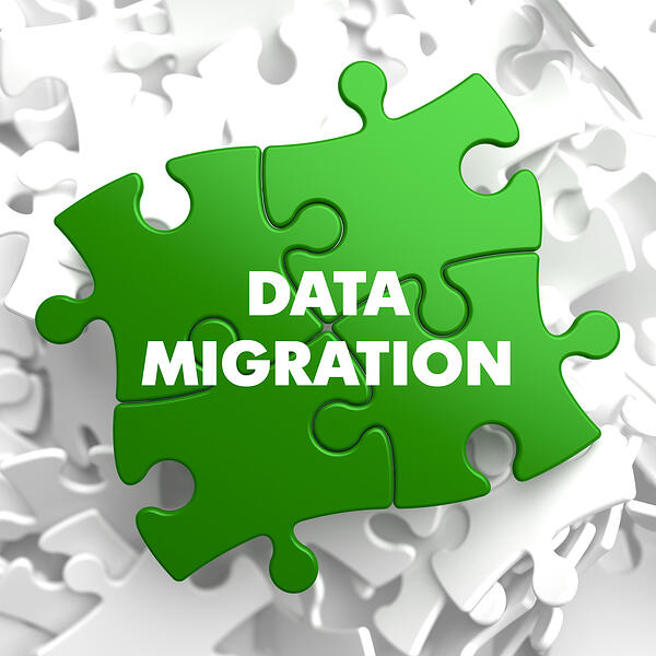 Data Migration on Green  Puzzle on White Background.