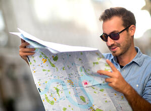Man looking lost and holding a map